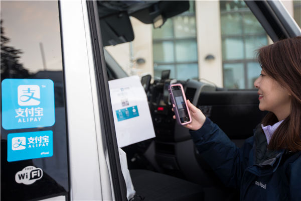 A Chinese visitor scans a code with her phone during a trip to Rovaniemi, Finland, where travelers can use Alipay, China's popular mobile-payment app, for payments. (Photo provided to China Daily)