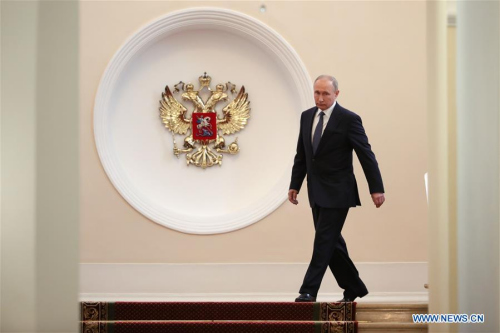 Russian President Vladimir Putin walks in the Kremlin before his inauguration ceremony in Moscow, capital of Russia, on May 7, 2018. Vladimir Putin took the oath of office Monday to start his fourth term as Russian president. (Xinhua/Sputnik)
