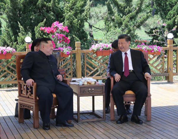 Xi Jinping (R), general secretary of the Central Committee of the Communist Party of China (CPC) and Chinese president, holds talks with Kim Jong Un, chairman of the Workers' Party of Korea (WPK) and chairman of the State Affairs Commission of the Democratic People's Republic of Korea (DPRK), in Dalian, northeast China's Liaoning Province, on May 7-8. (Xinhua/Ju Peng)