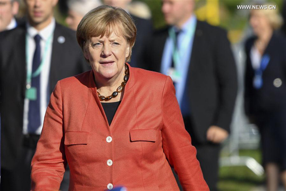 Merkel reaffirms commitment to nuke deal in call with Iranian president