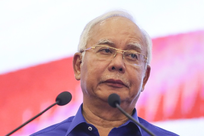 Former Malaysian PM Najib steps down as party president
