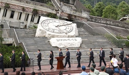 10 years on, president hails post-quake reconstruction