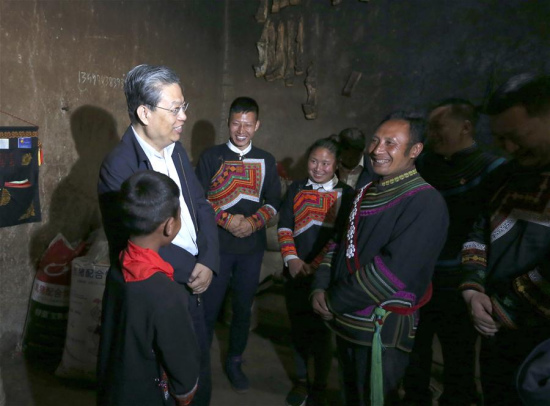 Secretary of the Communist Party of China (CPC) Central Commission for Discipline Inspection Zhao Leji, who is also a member of the Standing Committee of the Political Bureau of the CPC Central Committee and heads the central leading group on disciplinary inspection, visits a poor family during a tour to Leibo County in Liangshan Yi Autonomous Prefecture in southwest China's Sichuan Province. Zhao attended a workshop on disciplinary inspection in Chengdu of Sichuan on May 14, 2018. (Xinhua/Yao Dawei)