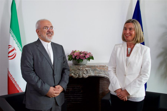 European Union (EU) foreign policy chief Federica Mogherini (R) meets with Iranian Foreign Minister Mohammad Javad Zarif in Brussels, Belgium, May 15, 2018. (Xinhua/European Union)