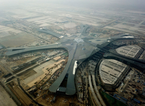 The roof of Beijing's new airport nears completion in January. Operations are to begin in October 2019. (Photo/Xinhua)