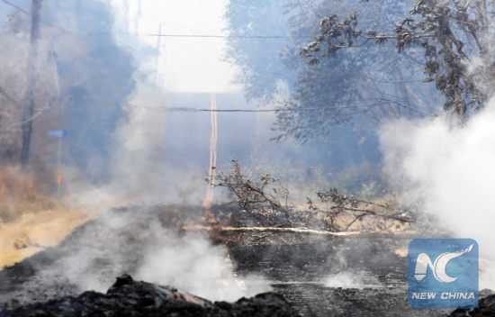 Volcanic debris are seen on a road in Leilani Estate, Hawaii, the United States, May 9, 2018. According to reports of the Hawaii State government, eruptions of the KilaueaVolcano had forced the evacuation of thousands of people. (Xinhua/Tao Xiyi)