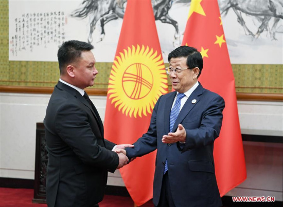 Chinese State Councilor and Minister of Public Security Zhao Kezhi (R) meets with Secretary of the Security Council of Kyrgyzstan Damir Sagynbayev, who is also head of a delegation attending the 13th meeting of Shanghai Cooperation Organization (SCO) Security Council Secretaries, in Beijing, capital of China, May 21, 2018. (Xinhua/Zhang Ling)