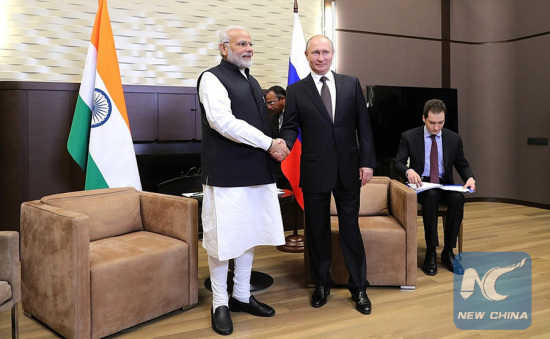 Russian President Vladimir Putin shakes hands with visiting Indian Prime Minister Narendra Modi in Sochi, Russia, May 21, 2018. (Kremlin Photo)