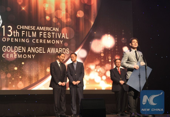 Stu Levy (front), who chairs the International Committee of Producers Guild of America (PGA), addresses the opening ceremony of the 13th Chinese American Film Festival (CAFF), in Los Angeles, the United States, Nov. 1, 2017. (Xinhua/Gao Shan)