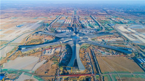 An aerial photo shows the construction site of Beijing's new airport in southern Daxing district in Beijing. (Photo by Yang Zhiyong/chinadaily.com.cn)