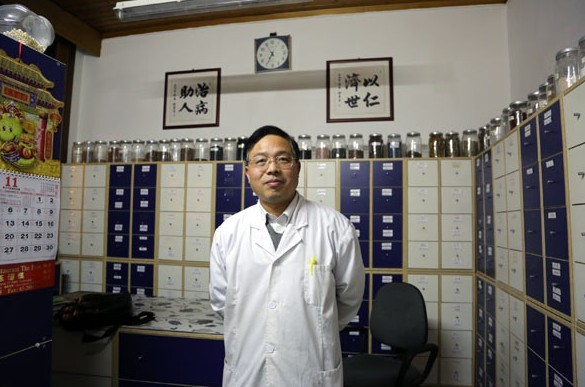 Wang Zhongbin, who has run a TCM clinic in Antwerp, Belgium, for eight years, says about 80 percent of his clients are non-Chinese. [Photo / China Daily]