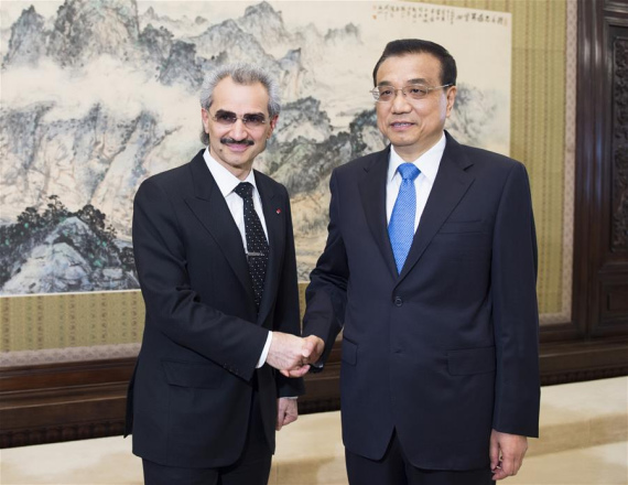 Chinese Premier Li Keqiang (R) meets with visiting Saudi Arabian Prince Alwaleed Bin Talal Bin Abdulaziz Alsaud, chairman of the Kingdom Holding Company, a leading investment holding company based in Riyadh, in Beijing, capital of China, May 19, 2016. (Photo: Xinhua/Xie Huanchi)