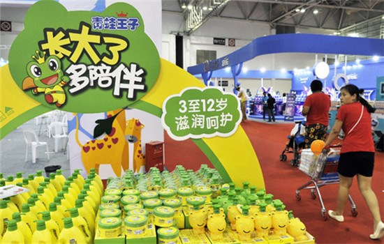 Customers walk by cosmetics products from Shanghai Jahwa United Co Ltd at an industry fair in Fuzhou, Fujian province.