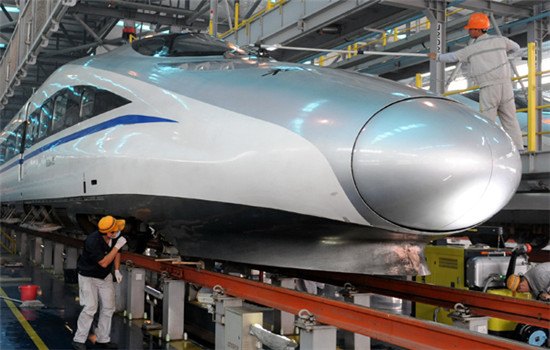 Workers check a bullet train locomotive manufactured by China Railway Rolling Stock Corp in Zhengzhou, Henan province. A CRRC subsidiary is considering a takeover of a Czech company to expand its market share in Europe. (LI BO / XINHUA)