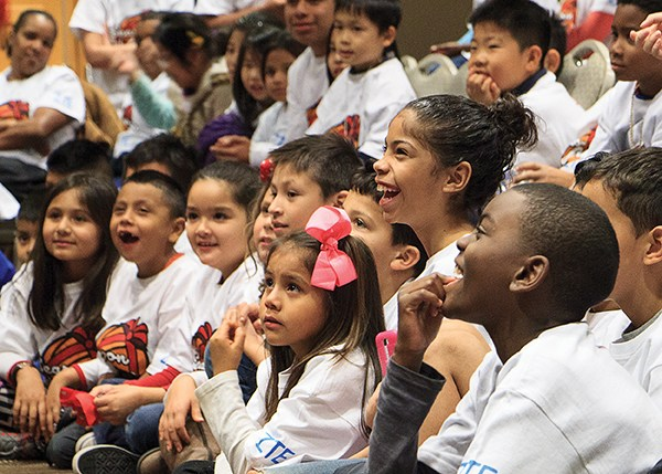 Children watch a performance of The Adventures of Sana Claus at ZTE and Houston Rockets' Season of Giving event on Monday night.