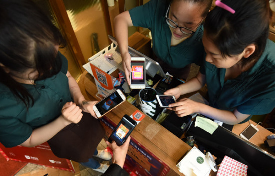 A restaurant in Hangzhou, Zhejiang province, uses King of Glory to attract more customers. The game has more than 200 million registered users. (Photo by Long Wei/For China Daily)