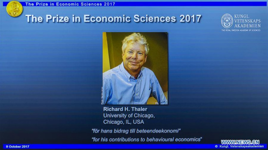 Photo of Richard H. Thaler is displayed on the screen during the press conference to announce the winner of the 2017 Nobel Prize in Economics in Stockholm, Sweden, on Oct. 9, 2017. (Xinhua/Shi Tiansheng)