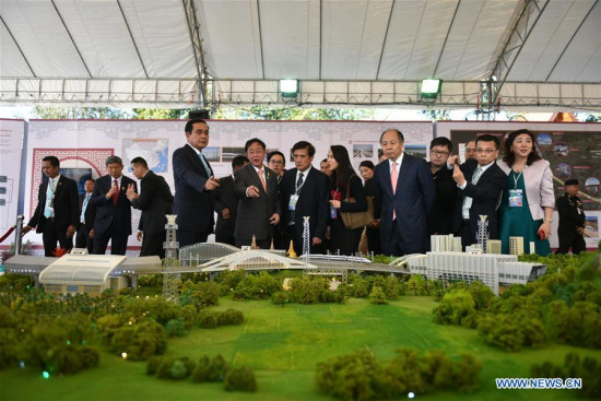 Honored guests visit a model of the first phase of the high-speed railway linking Bangkok with Nakhon Ratchasima province in Pak Chong, Thailand, Dec. 21, 2017. Thailand and China jointly inaugurated the construction of Thailand's first high-speed railway from Bangkok to northeastern province of Nakhon Ratchasima on Thursday. (Xinhua/Li Mangmang)