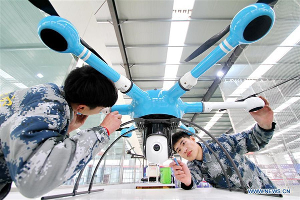 Technicians work on an unmanned aerial vehicle, north China's Hebei Province, Dec. 26, 2017. China's economy grew 6.9 percent year on year in 2017, well above the official target of around 6.5 percent, data from the National Bureau of Statistics (NBS) showed Thursday. Gross domestic product (GDP) totaled 82.71 trillion yuan (about 12.84 trillion U.S. dollars) in 2017, with the service sector accounting for more than half of the total. (Xinhua/Mu Yu)