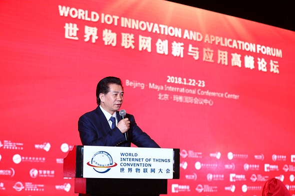 He Xuming, executive chairman of the World Internet of Things Convention, gives a speech at the World IoT Innovation and Application Forum held in Beijing on Jan 22, 2018. (Photo provided to chinadaily.com.cn)