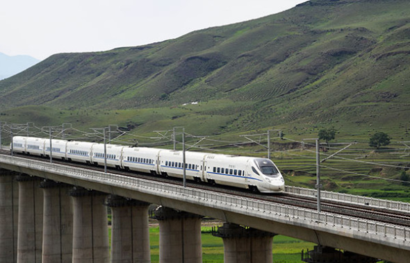 A high-speed train heads to Ulanqab from Hohhot in the Inner Mongolia autonomous region in August, marking the openning of the region's first high-speed railway. (Photo by Tang Zhe/For China Daily)