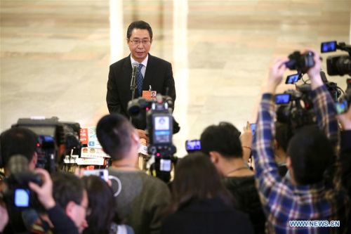 Shen Changyu, director of the State Intellectual Property Office, answers media questions after the fourth plenary meeting of the first session of the 13th National People's Congress at the Great Hall of the People in Beijing, March 13, 2018. (Photo/Xinhua)