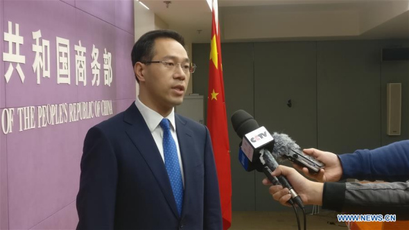 Gao Feng, spokesperson for China's Ministry of Commerce, is interviewed in Beijing, capital of China, April 6, 2018. China will fight