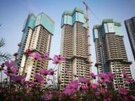 China's property loan growth slows amid tough purchase restrictions