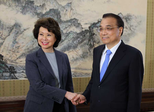 Premier Li Keqiang shakes hands with US Secretary of Transportation Elaine Chao at the Zhongnanhai leadership compound in Beijing on Thursday. Chao congratulated Li on China's economic performance in continuing to maintain a high growth rate. She also said she hopes the two nations will reach a positive outcome in trade and economic talks. (Photo/China Daily)