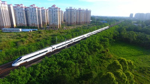 Photo taken on May 6, 2018 shows a bullet train running on the high-speed loop line near Qionghai city, South China's Hainan province. The 653-km high-speed railway line circling the island received over 25 million passengers in 2017. (Photo/Xinhua)