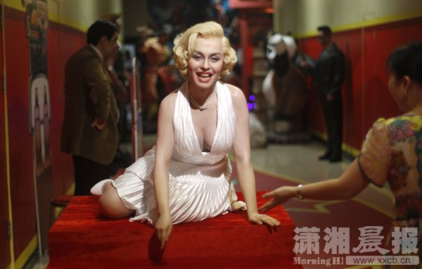 The wax figure of Marilyn Monroe is placed at the gate of the wax ...