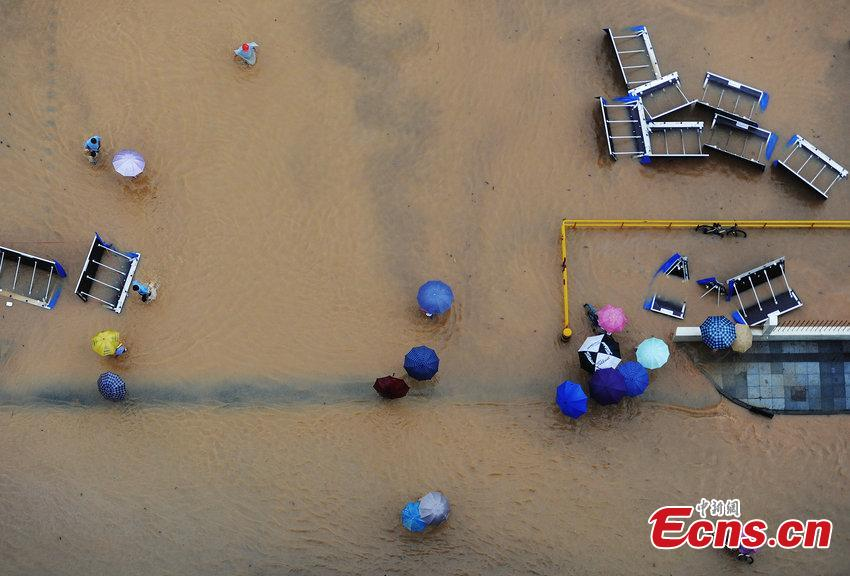 People catch fish on flooded street in south china city 4 4 for People catching fish