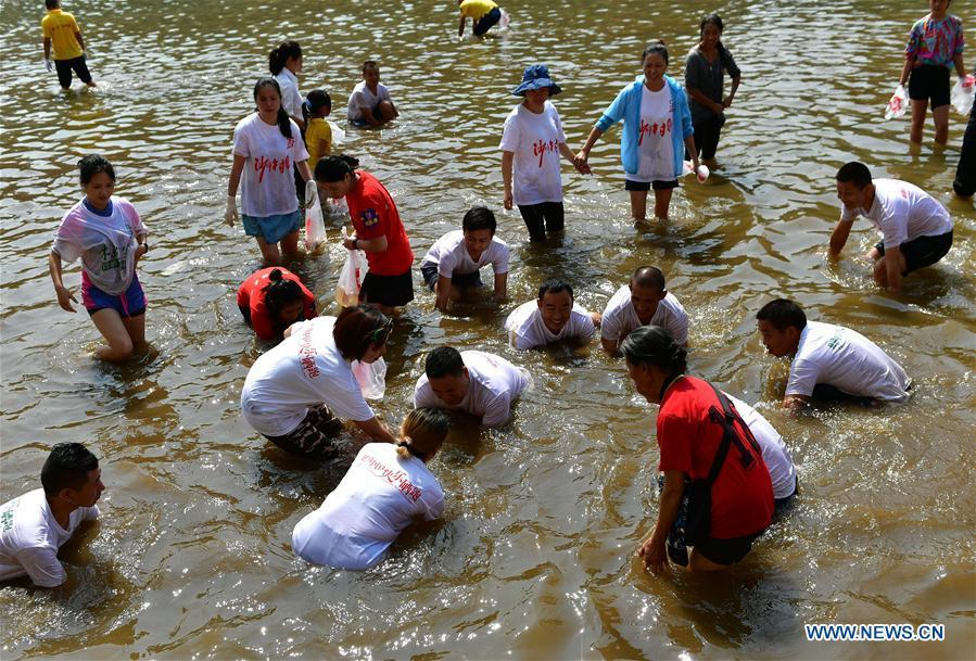 People catch fish in river to celebrate good harvest 2 6 for People catching fish
