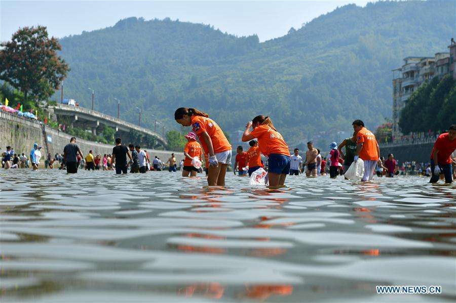 People catch fish in river to celebrate good harvest 3 6 for People catching fish