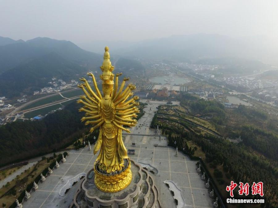 An aerial view of a thousand-hand Bodhisattva sculpture at the Miyin Temple in Ningxiang County, Central China's Hunan Province, Dec. 29, 2016. The sculpture, at 99.19 meters tall, is said to be the largest outdoor thousand-hand Bodhisattva sculpture. (Photo: China News Service/Yang Huafeng)