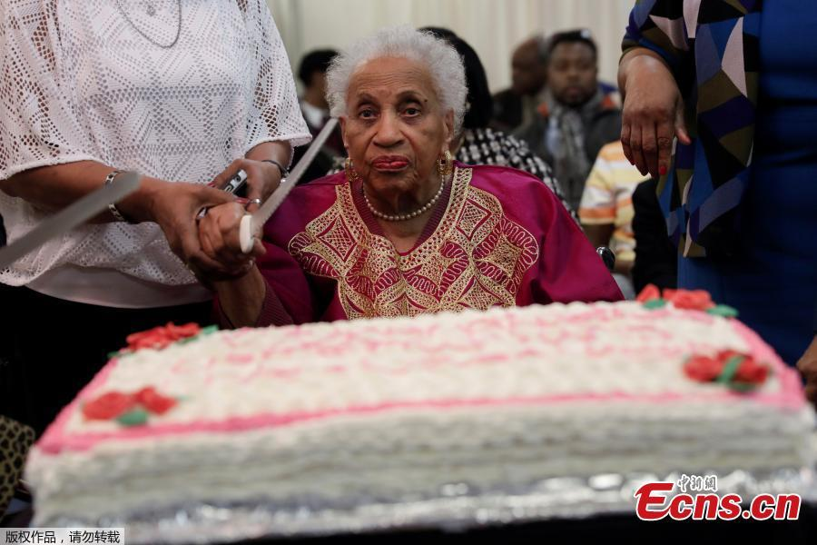101 Year Old Lucille Price Cuts A Cake At Birthday Celebration For Three