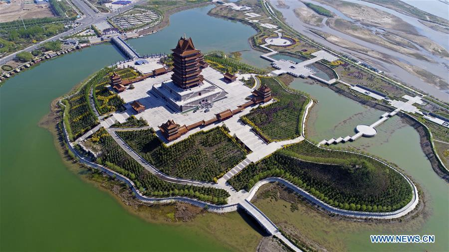 Photo taken on April 27, 2017 shows Huanghe Cultural Park in Qingtongxia City, northwest China\'s Ningxia Hui Autonomous Region. Located on the west bank of the Yellow River, the main building of the park is 108 meters high and is used as an exhibition hall to display Yellow River cultures. (Xinhua/Wang Peng)