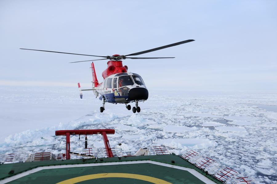 A helicopter takes off from the deck of the Snow Dragon for inspection of the floating sea ice, Dec 4, 2017. [Photo/Xinhua]