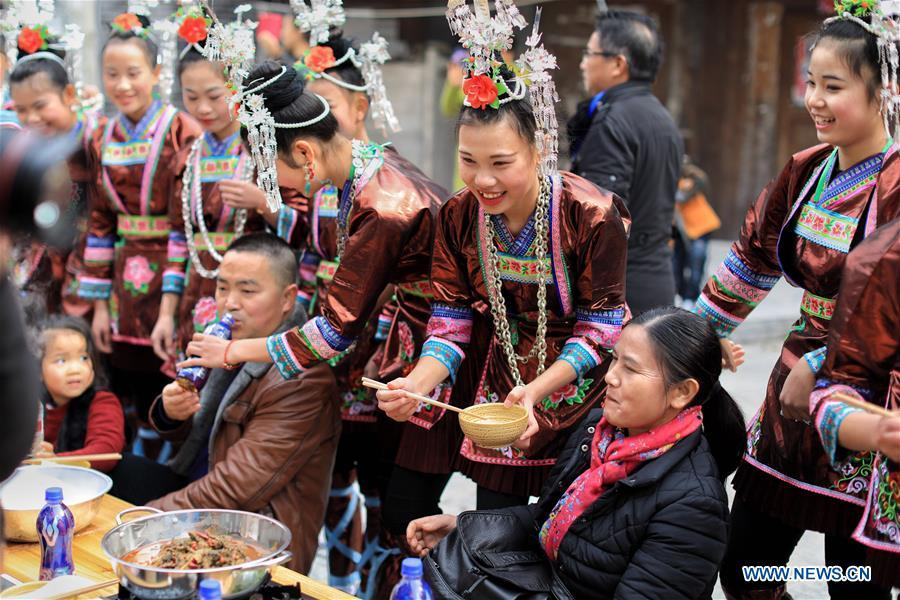 rongjiang black singles 17 days guizhou yunnan colorful minority tour  experience local miao people's traditions dating back  marvel at groups of gray-black stone peaks and climb up.