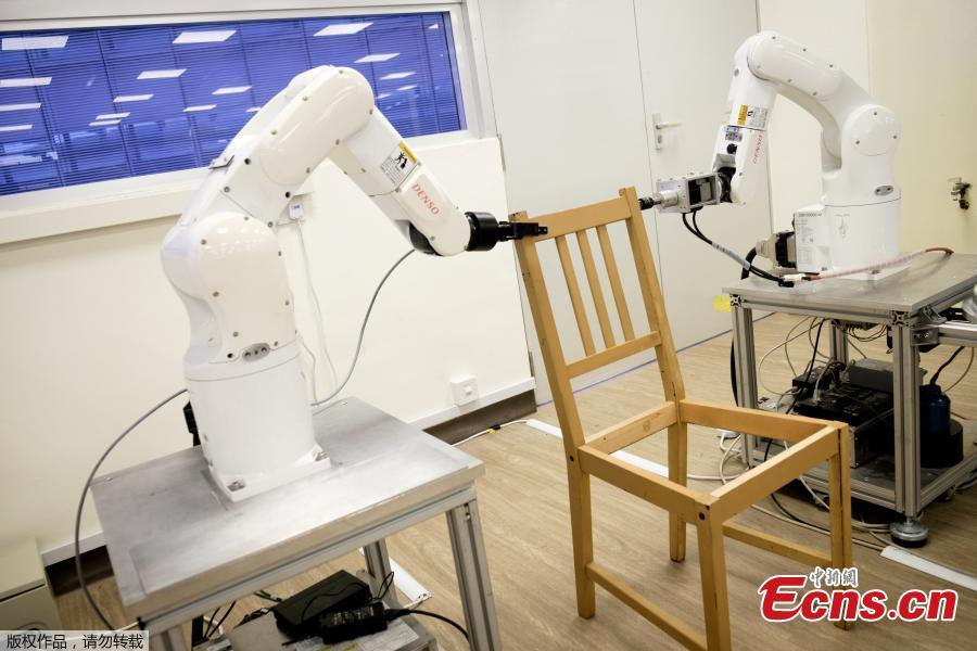 Nanyang Technological University, Singapore (NTU Singapore) scientists have developed a robot that can autonomously assemble an IKEA chair without interruption. Designed by Assistant Professor Pham Quang Cuong and his team from NTU\'s School of Mechanical and Aerospace Engineering, the robot comprises a 3D camera and two robotic arms equipped with grippers to pick up objects. The team coded algorithms using three different open-source libraries to help the robot complete its job of putting together the IKEA chair. It assembled IKEA\'s Stefan chair in 8 minutes and 55 seconds. (Photo/Agencies)