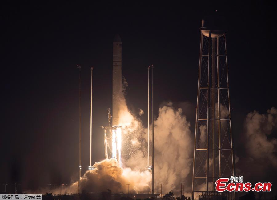 The Orbital ATK Antares rocket, with the Cygnus spacecraft onboard launches at NASA\'s Wallops Flight Facility in Virginia, May 21, 2018. The Orbital ATK launched a fresh load of supplies to the International Space Station. Named for the swan constellation, the Cygnus is making Orbital ATK's ninth contracted delivery for NASA. SpaceX is NASA's other supplier. (Photo/Agencies)