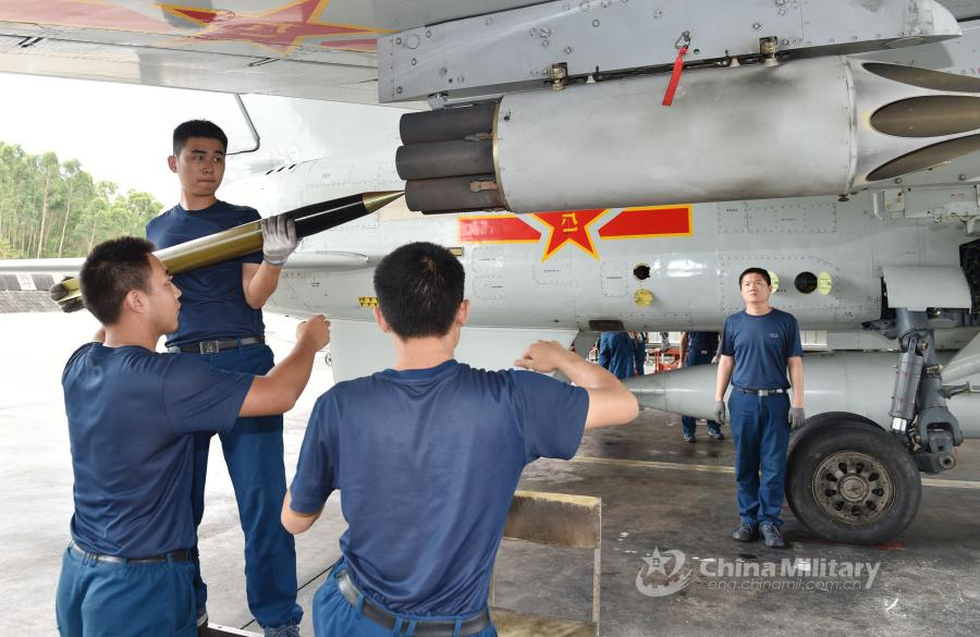 Ordnancemen assigned to an aviation brigade of the South China Sea Fleet under the PLA Navy load ammunition onto a fighter jet prior to a live-fire training exercise at a shooting range in the South China Sea from May 17 to 18, 2018. (Photo/eng.chinamil.com.cn)