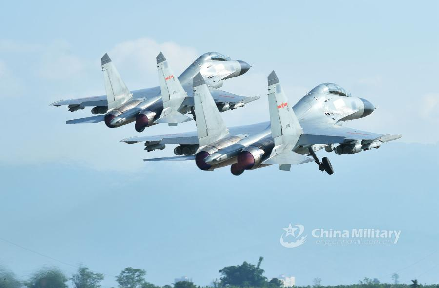 Two fighter jets attached to an aviation brigade of the South China Sea Fleet under the PLA Navy take off in formation for a live-fire training exercise at a shooting range in the South China Sea from May 17 to 18, 2018. (Photo/eng.chinamil.com.cn)
