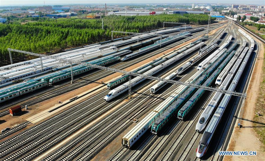Aerial photo taken on May 10, 2018 shows rail vehicles produced by the CRRC Qingdao Sifang Co., Ltd. in Qingdao, a coastal city in east China\'s Shandong Province. Home to Tsingtao Beer and home appliance giant Haier, Qingdao is becoming a more attractive place to run important multilateral events. In June, the coastal city will host the 18th summit of the Shanghai Cooperation Organization (SCO). (Xinhua/Li Ziheng)