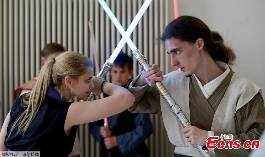 Young people perform during a training session at the \'Jedi Academy Cham\' in Loibling near Cham, Germany, May 19, 2018. The \'Jedi Academy\' is the only registered lightsaber show fight school in Germany. (Photo/Agencies)