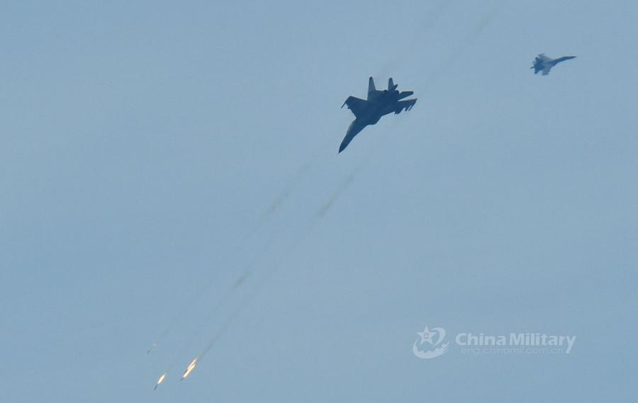 A fighter jet attached to an aviation brigade of the South China Sea Fleet under the PLA Navy fires at mock sea targets during a live-fire training exercise at a shooting range in the South China Sea from May 17 to 18, 2018. (Photo/eng.chinamil.com.cn)
