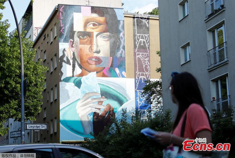 An artwork of urban artist Elle is pictured as part of the first Berlin Mural Fest 2018, where local and international urban artists create a large open-air gallery to enrich urban spaces in Berlin, Germany, May 21, 2018. (Photo/Agencies)
