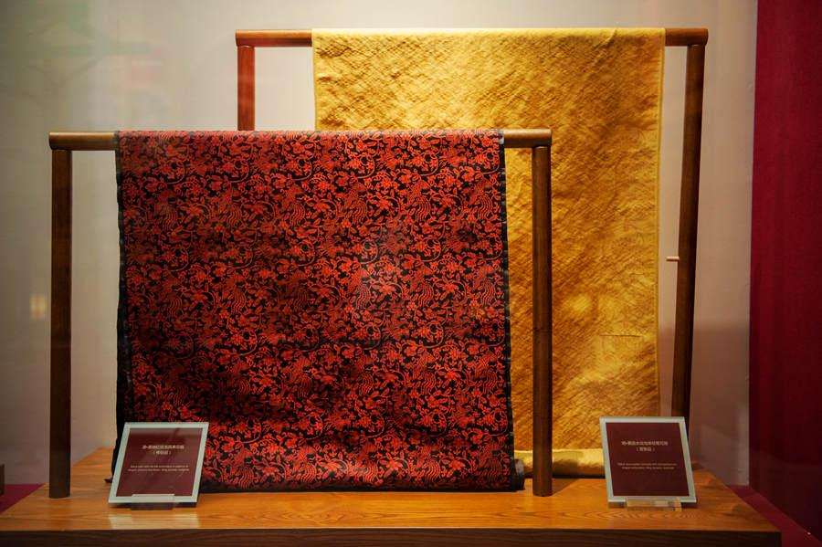 A Qing Dynasty (1644-1911) black satin with red silk embroidery in patterns of dragon, phoenix and flower. (Photo provided to chinadaily.com.cn)  Boasting a history of more than 1,600 years, the Nanjing yunjin brocade is considered the most extravagant silk fabric worn by emperors in ancient times. Its Chinese name yunjin literally refers to the cloud-like splendor of the fabrics.  The Nanjing Yunjin Museum, located in the eastern Chinese city of Nanjing, is dedicated to preserving the age-old weaving technique and creating a platform to promote textile exchanges in and outside China. The museum showcases fabrics, royal robes from Ming (1368-1644) and Qing (1644-1911) dynasties, replicas of the ancient fabrics, as well as techniques of the time-honored weaving art.   The craftsmanship of yunjin brocade was included on the UNESCO\'s Intangible Cultural Heritage List in 2009.