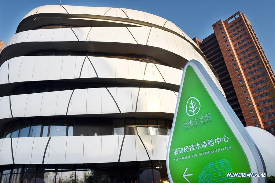 Photo taken on April 19, 2018 shows the Passive House Technology Center at the Sino-German Ecopark in Qingdao, a coastal city in east China\'s Shandong Province. Home to Tsingtao Beer and home appliance giant Haier, Qingdao is becoming a more attractive place to run important multilateral events. In June, the coastal city will host the 18th summit of the Shanghai Cooperation Organization (SCO). (Xinhua/Li Ziheng)
