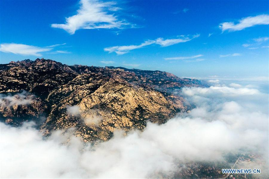 Aerial photo taken on May 19, 2018 shows sea of clouds over the Laoshan Mountain in Qingdao, east China\'s Shandong Province. (Xinhua/Guo Xulei)